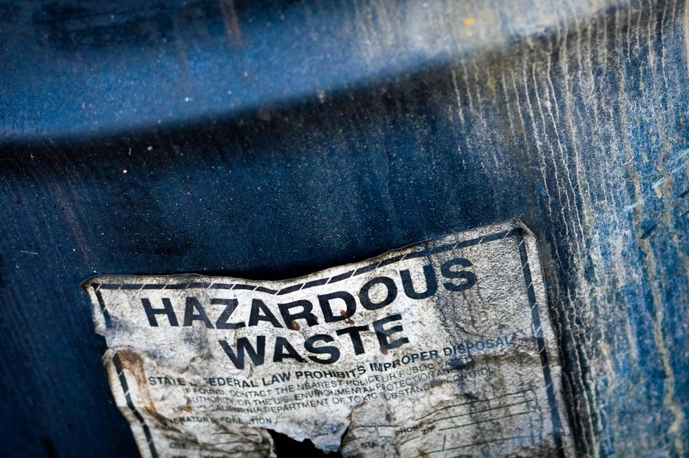 Drum of hazardous waste in open field
