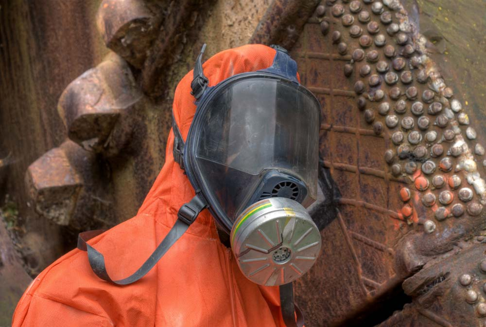 HAZWOPER respirator in use by worker